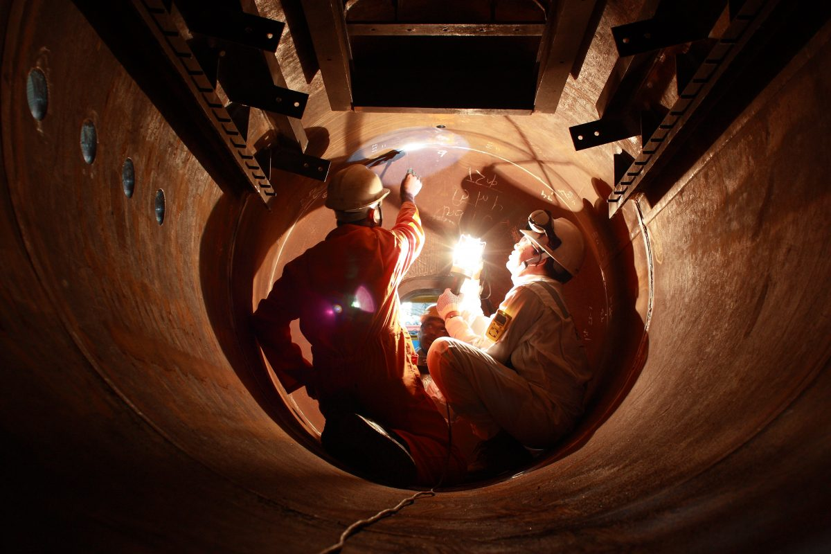 Surveyor inspecting weld seam setup
